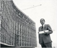 "Architect Emmanouel Vourekas in front of the (under construction) ""Athens Hilton"" hotel, 1958"