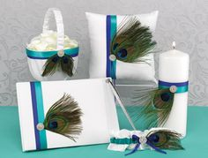 Peacock feather wedding accessories. Great ideas for peacock feather decor.