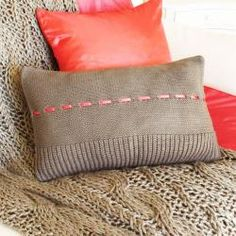 coral and taupe cushion