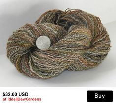 Wool yarn, handspun, 200 yards 2ply Romney wool yarn.  Gray with earth tone over dye, olive green, rust, brown, natural