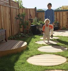 "Circular stepping ""stones"" and a semicircular mini deck made of rot-resistant Trex, a composite wood, punch up the design of a small outdoor space."