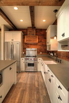 Country Kitchen with Wood Plank Ceiling (tongue & groove board), Custom hood, Farmhouse Sink, Natural wood, Wood panel wall