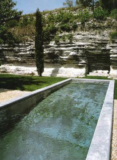 cement pool - look how they carved out the rock to create an overhang for the lounger
