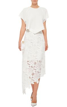 Cherished for her sleek, modern staples, for Resort 2016 Amy Smilovic fuses her effortlessly luxe separates with athletic details and decorative touches inspired by biology. This **Tibi** skirt is rendered in a floral lace and features a high rise, a column silhouette, and a midi length with an asymmetric hem.