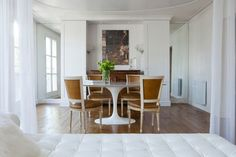 Interior Designer Benjamin Noriega-Ortiz of BNOdesign - love the camel colour neoclassical chairs w Saarinen dining table