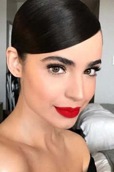 Who doesn't love a bold red lip? Choosing the right shade for your skin tone, however, can be a challenge. We've got the ultimate guide with some red flower inspiration to help you find your ideal shade. #redlips #makeup #bossbabe