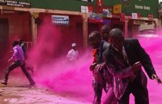Anti-riot police officers used colored water to disperse opposition supporters who had gathered in a Kampala, Uganda, suburb Wednesday to mourn people killed during demonstrations earlier this year.
