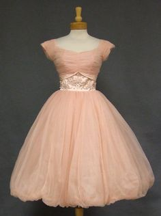 A lovely pink nylon 1950's cocktail dress fit for a princess.