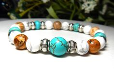 Mens beach bracelet is made with a 10mm Turquoise Howlite with 8mm White Howlite and Picture Jasper. Great colors! Howlite Properties: This calming stone is said to teach patience and to help eliminat