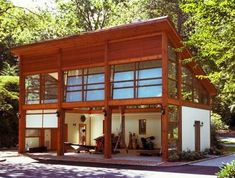 A modern garage and shed by Eisner Design LLC.  My ideal new garage would have a studio upstairs like this.