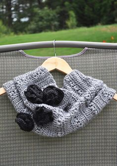 Ravelry: Rustic Crochet Cowl with Roses pattern by faima othman - I think that a sweater could be used to do something very similar.