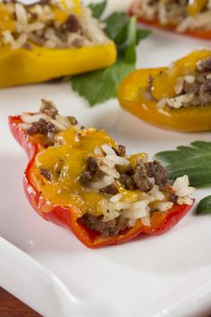 You know those mini sweet peppers at the store? Well we stuffed them with lean ground beef, cheese, and a little rice for a perfectly poppable potluck appetizer.