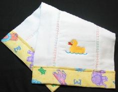 DIY Baby Burp Cloth -- love this style, but I don't have embroidery capabilities. Maybe I need to learn how to applique?