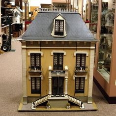 This impressive doll's house has an incredible façade of long windows with balconies on the second floor, double staircase on the front and...