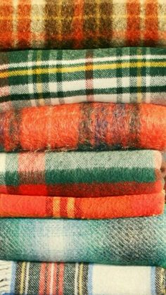 Mixed warm wool plaids in reds and greens.