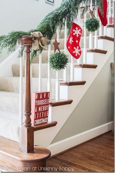 Christmas Decorating- Evergreen Garland, boxwood kissing balls, stockings on the stairs