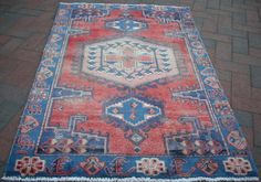 "great tips for finding inexpensive tribal rugs on Ebay | Design Manifest - search ""kazak rug"" or ""turkish rug"" or ""balouch rug"" or ""hamadan rug"""