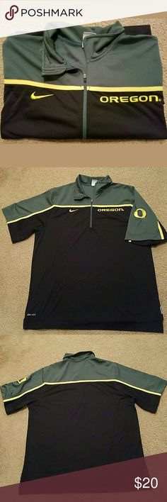 Nike Dri-Fit Men's Oregon Ducks Pullover Size XL This is a really great pre-owned Nike Dri-Fit Men's Oregon Ducks Short Sleeve Pullover Size XL. It is in good pre-owned condition. There are no holes, stains, rips or tears anywhere in the fabric. The zipper slides smoothly and easily. It is 109% Polyester. It is black, green and yellow in color.  Measurements are: Armpit to Armpit: 25.5 inches  Length: 31 inches Nike Shirts Tees - Short Sleeve