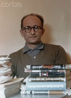 Adolf Eichmann With Books - BE053015 - Rights Managed - Stock Photo - Corbis. Original caption:4/1961- Jerusalem, Israel- Adolf Eichmann, close-ups in Teggart Fortress prior to his removal to Jerusalem Court House.