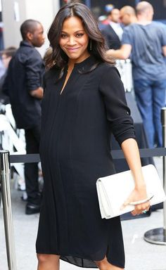 Zoe Saldana from Stars at New York Fashion Week Spring 2015 Zoe Saldana from Stars at New York Fashion Week Spring 2015 Talk about glowing! The mom-to-be stuns in a loose black shirt-dress. Stylish Maternity, Maternity Wear, Maternity Fashion, Maternity Dresses, Fashion Maman, Pregnancy Outfits, Pregnancy Info, Pregnancy Dress, Pregnancy Style