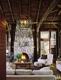 Southampton, N.Y. family room by interior designer Mariette Himes Gomes and architect John Mayfield. Salvaged wood & stacked stone set a rustic tone.