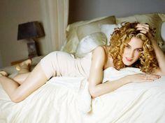 Character Carrie Bradshaw wears a DKNY nude slip dress