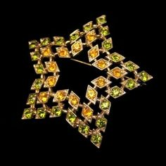 Sarah Coventry Vintage Brooch Pin Large Star Green Orange Rhinestones, $44.95 from http://stores.ebay.com/My-Classic-Jewelry-Shop. This gorgeous star brooch has sparkling orange and green rhinestones. :)