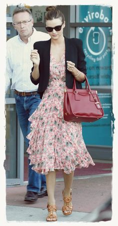 Miranda Kerr Street Style Snapshot - Flirty Floral   Miranda Kerr Street Style Snapshot - Flirty Floral Miranda Kerr worked the feminine trend in a flirty floral dress while visiting a hospital in Sydney. The Victoria Secret model and mother to an adorable Kerr-Bloom baby completed the look with a red Prada satchel, black blazer, and leather sandals.