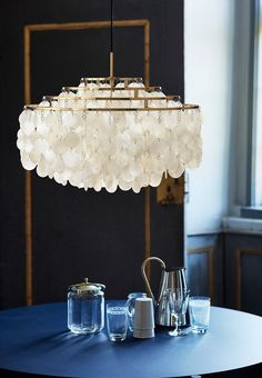 Verner Panton's iconic chandelier lamp with new brass finish.