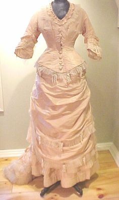 Wedding gown with lily trim, circa 1875