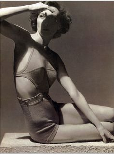 Model in Jantzen suit with daringly cutaway sides.  Photo by Horst P. Horst, Vogue 1934.