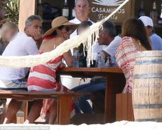 Kicking back: The group appeared to be in great and relaxed spirits as they happily chatted away in Mexico, Dec. 27, 2014.