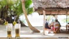 Stock Video of Stop motion of Pina Colada cocktails at rustic restaurant among palm trees on white sandy beach in summer time with star fruit. at Adobe Stock Rustic Restaurant, Pina Colada, Stop Motion, Stock Video, Palm Trees, Stock Footage, Summer Time, Adobe, Cocktails