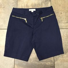 MK shorts size 6 Gently worn MK Shorts. Accented with gold MK zippers. Mid thigh length navy! Michael Kors Shorts Bermudas