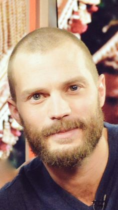 Jamie Dornan. Not used to seeing him with such light hair (hardly any hair really)