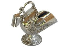 "Italian Sugar Scuttle As described by Chateau et Jardin Silverplated sugar scuttle and scoop with floral design. Marked ""Leonard Italy Silverplated."" 119"