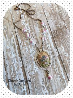 Fairy Cameo Necklace .. 40x30mm ..  The Fairy Cameo is painted and is mounted on a beautiful bezel that is also painted light pink with small rhinestones surrounding the cab .. Beautiful pink rose glass beads, pearls and copper chain complete this beauty ... .. FOR SALE $42,00 .. https://www.etsy.com/shop/CleverDesignsbyJann