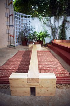 DIY balance beam - like the rug underneath instead of fabric and foam all over the beam.