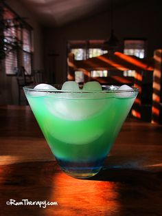 Tropical Leprechaun    2 oz. Coconut Rum   .5 oz. Blue Curacao Liqueur  Pineapple Juice    Using a rocks glass full of ice, pour in the rum and Blue Curacao, then top it off with pineapple juice. Stir the top slightly, leaving the blue on the bottom of the glass – until the drink turns green.