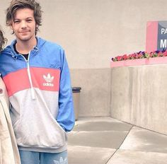 Louis Tomlinson in his favorite gift from a fan, an ADIDAS jumper!
