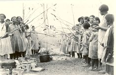 "Girls at weiner roast, Edmonton Indian Residential School, circa 1930. Many First Nations children were taken from their homes and communities in Canada's attempt to ""civilize"" them into European agri-industrialists. Care was poor and their languages forbidden. Many children were abused. Many died. PM Harper was the first to formally apologize. However since then he has repeatedly refused Inuit and First Nations envoys."
