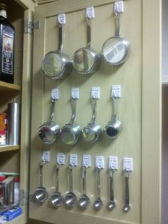 Hang all my measuring cups and measuring spoons using 2 packs of self adhesive hooks from the dollar tree. This might also work for some of the cooking utensils.  May have to consider as I reorganize the kitchen.: