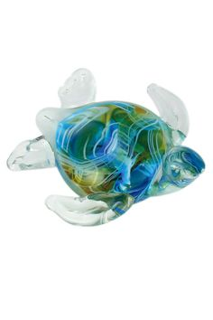 Ocean Ripples are Captured In Glass Our Sea Swirl Sea Turtle has captured the beauty of the ocean right in its shell with ocean aqua blue, sunset amber and stripes of sea foam.