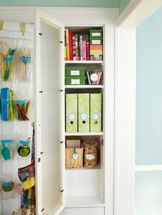Loving the idea of an inexpensive shoe organizer hung on the inside of a door for craft storage as well as labeled baskets, boxes and magazine files to keep your shelves organized.