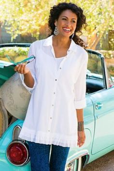 "Soft cotton voile shirt has a double-ruffle hem. Detailed with long roll-tab sleeves and a shaped waist. Comes with matching adjustable-strap cami. Misses 32"" long."
