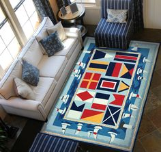 Nautical Area Rugs: http://www.caronsbeachhouse.com/nautical-area-rugs/ These nautical rugs feature classic nautical motifs from sailboats to signal flags to anchors and more.