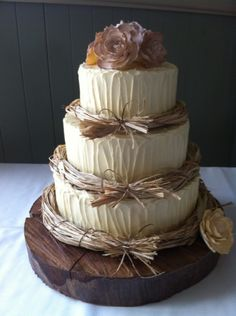 Love the tree stump cake stand, minimal flowers on top and the twine layer borders.