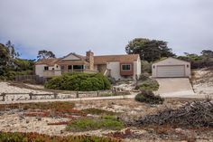Have you been looking for a Pacific Grove ocean view home for sale perched in the sand dunes close to Asilomar State Beach?  These homes do not come on the market that often, so you must take a look at this 3 bedroom, 2 bathroom cottage with views of Monterey Bay.
