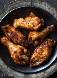Barbecued Buffalo Wings ~ Slow barbecued chicken wings slathered in a classic Buffalo wing sauce. ~ SimplyRecipes.com