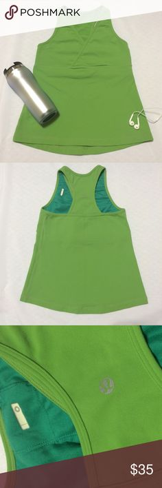 Lululemon Deep V Tank Excellent condition Deep V tank by Lululemon. Built in inner bra (no padding). Racerback styling with the Lululemon logo In the center. Inside tag was removed. Size 0. No pilling or visible signs of wear.  Exterior is a lime green and the inside bra is a teal. lululemon athletica Tops Tank Tops